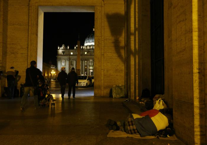 Homeless person sleeps outside Vatican press office near St. Peter's Square