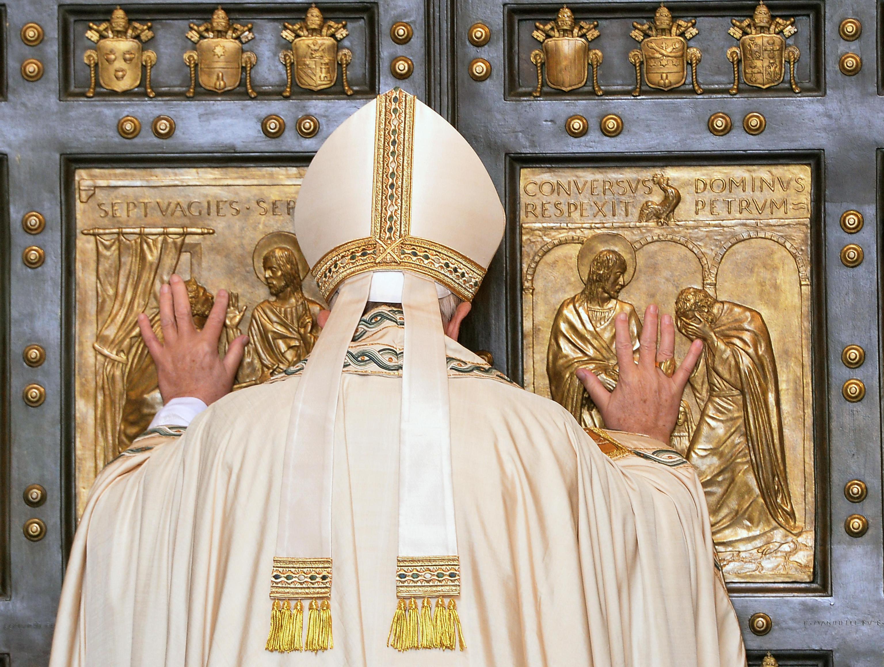 Pope Francis opens the Holy Door of St. Peter's Basilica to inaugurate the Jubilee Year of Mercy at the Vatican Dec. 8. (CNS photo/Maurizio Brambatti, EPA) See POPE-MERCY-DOOR Dec. 8, 2015.