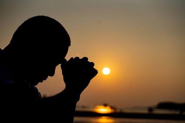 Praying at dusk